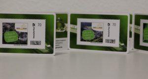 Drei eigene Briefmarken hat die Gemeinde Burbach herausgegeben. Ab sofort sind die kleinen Werbeträger im Bürgerbüro der Gemeinde erhältlich. (Foto: Gemeinde Burbach)